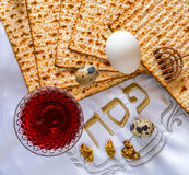 Traditional food matzah, eggs and drink of red wine for Jewish Passover Holiday Royalty Free Stock Image