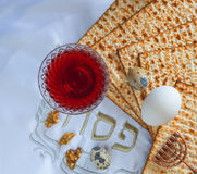 Traditional food matzah, eggs and drink of red wine for Jewish Passover Holiday Royalty Free Stock Images