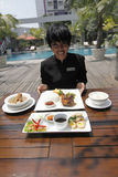 Traditional food menu. Food and beverage attendant shows the new menu traditional nuances in a hotel in the city of Solo, Central Java, Indonesia Royalty Free Stock Image