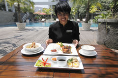 Traditional food menu. Food and beverage attendant shows the new menu traditional nuances in a hotel in the city of Solo, Central Java, Indonesia Stock Photography