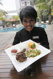 Traditional food menu. Food and beverage attendant shows the new menu traditional nuances in a hotel in the city of Solo, Central Java, Indonesia Stock Photos