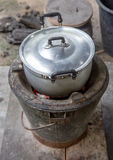 Traditional food preparation in a tin pot Royalty Free Stock Photos