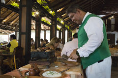 Traditional food in a restaurant of Bolivia in Santa Cruz. Traditional food of Latin America. Waiter preparing barbecue in a famous restaurant in Santa Cruz Royalty Free Stock Photos