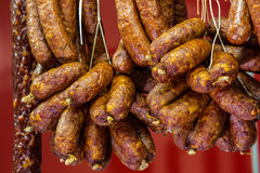 Traditional food. Smoked sausages meat hanging in european food royalty free stock image