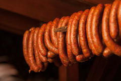 Traditional food. Smoked sausuages in smokehouse. Stock Photo