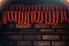 Traditional food. Smoked sausuages in smokehouse. Royalty Free Stock Photography