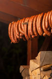Traditional food. Smoked sausuages in smokehouse. Royalty Free Stock Photo