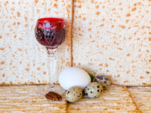 Traditional food and wine for Jewish Passover. Background with unleavened bread  - matzoth in Hebrew Stock Image