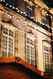 Strasbourg building Christmas market. Traditional French architecture building with Christmas decorated lights at night in Strasburg France Royalty Free Stock Images