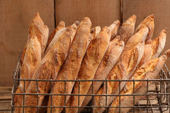 Traditional French baguette in a metal basket.  Stock Image