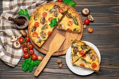 Traditional french Baked homemade quiche pie on wooden board stock photo