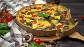 Traditional french Baked homemade quiche pie on wooden board stock footage