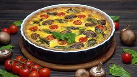Traditional french Baked homemade quiche pie on wooden cutting board stock footage