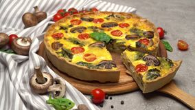 Traditional french Baked homemade quiche pie on wooden cutting board stock video footage