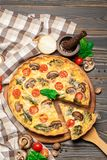 Traditional french Baked homemade quiche pie on wooden board royalty free stock photo