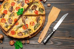 Traditional french Baked homemade quiche pie on wooden board royalty free stock photos
