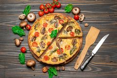 Traditional french Baked homemade quiche pie on wooden board royalty free stock photography