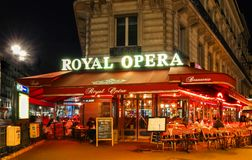 The traditional French cafe brasserie Royal Opera at night., Paris, France. Royalty Free Stock Image