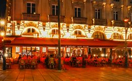 The traditional French cafe Le depart Saint Michel at night, Paris, France. Stock Image