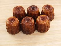 Traditional French cakes canelé royalty free stock photos