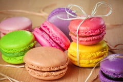 Traditional french colorful macarons with a bow Stock Photos