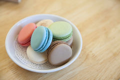 Traditional french colorful macarons in a dish on the table Stock Images