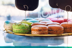 Traditional french colorful macaroons in confectionery shop. Display of delicious pastries in a bakery. Royalty Free Stock Photos