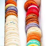 Traditional french colorful macaroons in a rows in a box. Extreme shallow depth of field with selective focus. Royalty Free Stock Photo