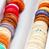 Traditional french colorful macaroons in a rows in a box. Extreme shallow depth of field with selective focus. Royalty Free Stock Images