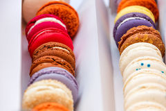 Traditional french colorful macaroons in a rows in a box. Extreme shallow depth of field with selective focus. Stock Photo