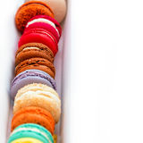 Traditional french colorful macaroons in a rows in a box with space for your text. Extreme shallow depth of field with selective f Royalty Free Stock Photo