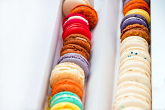 Traditional french colorful macaroons in a rows in a box with space for your text. Extreme shallow depth of field with selective f Stock Photo