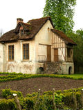 Traditional French Cottage with Thatched Roof and Garden Royalty Free Stock Photos
