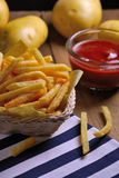 Traditional French fries with ketchup on table Stock Image