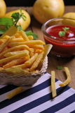 Traditional French fries with ketchup on table Royalty Free Stock Photography