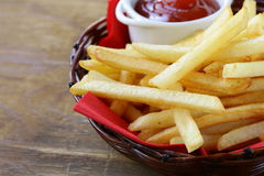Traditional French fries with ketchup Stock Photos