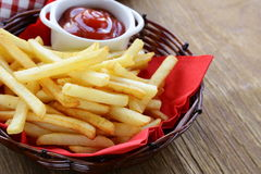 Traditional French fries with ketchup Royalty Free Stock Photography