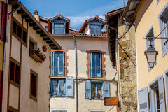 Traditional French houses with typical windows. France. Lantern and old wooden shutters on a building in French village royalty free stock photo