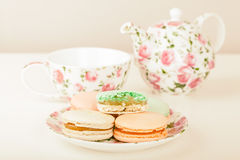 Traditional French Macarons against tea set Stock Photo