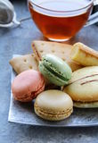 Traditional french macarons with tea set Royalty Free Stock Photo