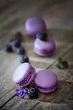 Traditional french macaroons with blueberries. Wood stock photos