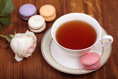 Traditional french macrons with tea set Stock Photo