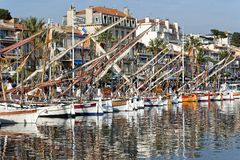 Traditional French mediterranean sailing fishing boats. Photo of traditional French mediterranean sailing fishing boats, restored and on show at the harbour stock photography