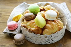 Traditional French pastries croissants and macaroons Stock Images