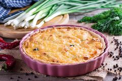 Traditional french pie with bacon and cheese - quiche lorraine.