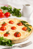 Traditional french quiche pie with salmon and cherry tomato Royalty Free Stock Photography