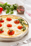 Traditional french quiche pie with salmon and cherry tomato Stock Photos