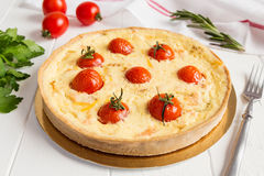 Traditional french quiche pie with salmon and cherry tomato Stock Images