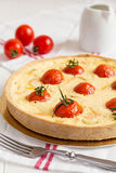 Traditional french quiche pie with salmon and cherry tomato Royalty Free Stock Image