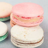 Traditional French sweets Macarons close up. Traditional French sweets Macarons on shiny grey background Stock Photo